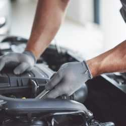 auto-mechanic-working-garage-repair-service_146671-18358